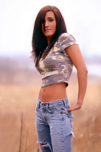 Pretty young Native American woman in blue jeans